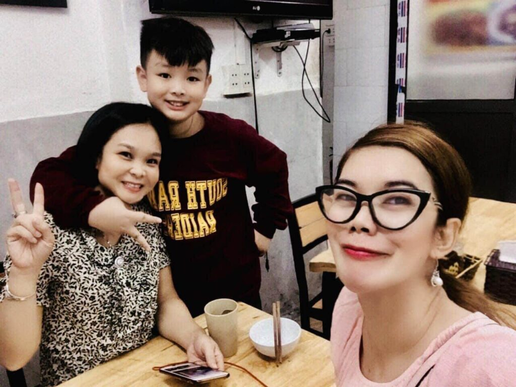 A Filipino teacher with her student and his mother on the Teacher's Day